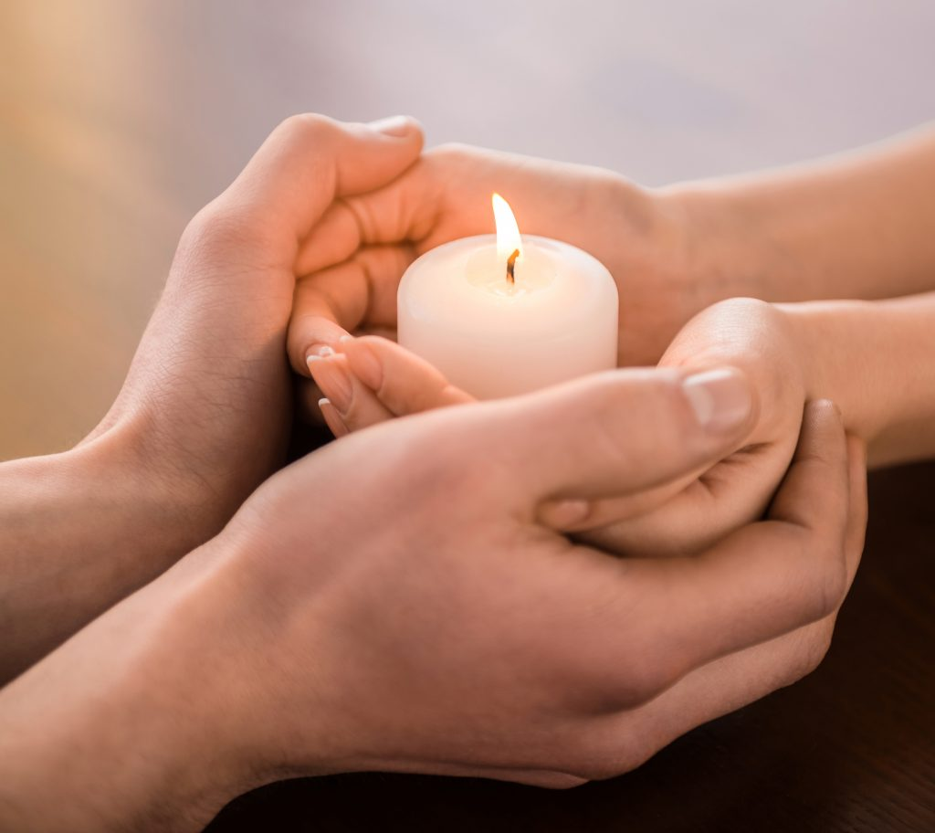 Holding a candle